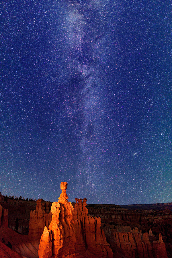 """Starry night sky and the Milky Way over the Thor's Hammer hoodoo, in Bryce Canyon National Park. This is actually the stitching together of five 15-second exposures. """"Reflected"""" light painting coming from left of camera. Camera aimed towards northeastern sky. Note The Great Andromeda Galaxy (M31) and the Double Cluster.  Virtually all my NightScapes are ONE exposure (less than 30 seconds), and with very little Photoshop correction. For more how-to and behind the scenes information, visit my <a href=""""http://intothenightphoto.blogspot.com/"""">Into The Night Photography</a> blog. For Milky Way photography workshops, visit my <a href=""""http://intothenightphoto.blogspot.com/2013/11/royce-bairs-2014-photography-workshop.html"""">NightScape Events</a> page. You can <a href=""""http://roycebair.smugmug.com/Personal-Work/Nightscapes/"""">order PRINTS here</a>."""
