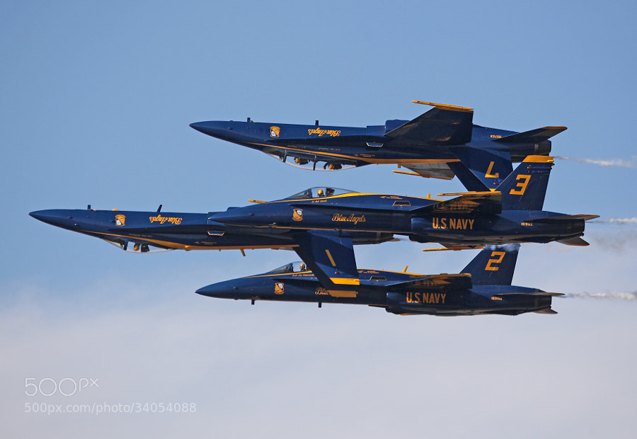 """The US Navy Blue Angels Flight Demonstration Team performing one of their patented maneuvers, the """"Double Farvel."""""""