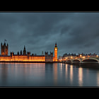 An image of the London Houses of Parliament, Elizabeth Tower, the Westminster Bridge and the River Thames was on my list of quintessential London scenes to capture during our fleeting five-day visit.  On the first night, it was wet and miserable, and my efforts down at Tower Bridge weren't as pleasing as I had hoped.  On night two, we were on our way back to London from Ely and Cambridge, so a twilight shoot was not possible.  Night three saw us catching up for dinner with some good friends who have recently moved to London for a few years.  Night four was my last chance to capture the iconic scene.The weather has been wet, cold and windy for the entire duration of the trip, but I decided that I was going to capture my image no matter what the weather presented.  After standing in cold rain for over an hour, waiting for the right light and for the lights to switch on and illuminate my subject, I finally landed my image.  It was worth it.