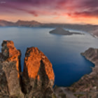 Crater Lake is just awesome! I took this shot late in the day after scaling the outer rim for a spot opposite the sun. The last light illuminated the rocks in the foreground for just a few minutes while the sky displayed amazing tones of red and purple.