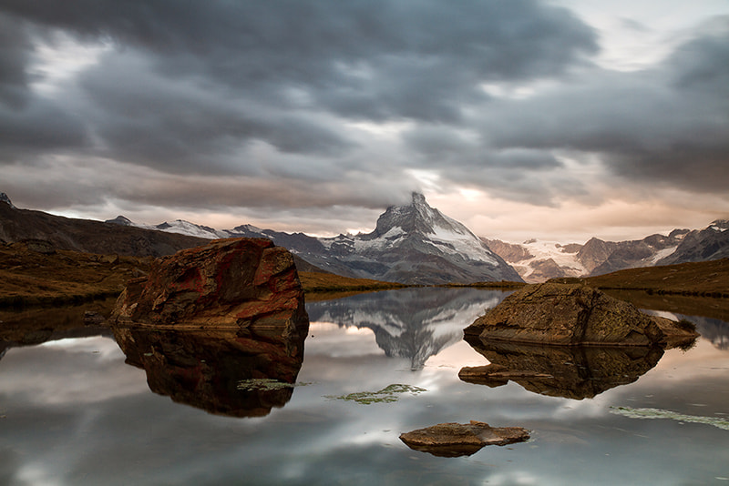 Photograph Stellisee and smoking Matterhorn by Gilles Monney on 500px