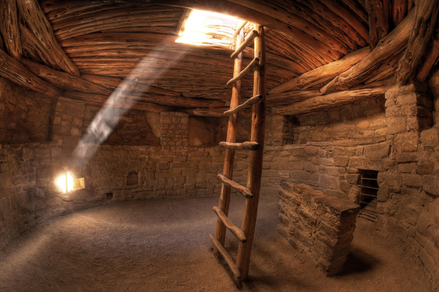 This ancestral Pueblo Kiva is located in Mesa Verde National Park, southwestern Colorado. Traditionally a secluded place for ceremony and worship by the men of the Pueblo tribes, Kivas were built underground or in caves, and included a firepit, with a cleverly designed air shaft to draw in fresh air.  This photograph captures more than beautiful warm color and the drama of light in a dark space. It also pulls the viewer inside, letting us experience the close walls, low ceiling and sense of tranquility.