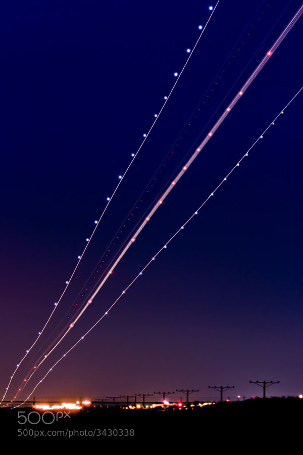 A long exposure of a plane landing.
