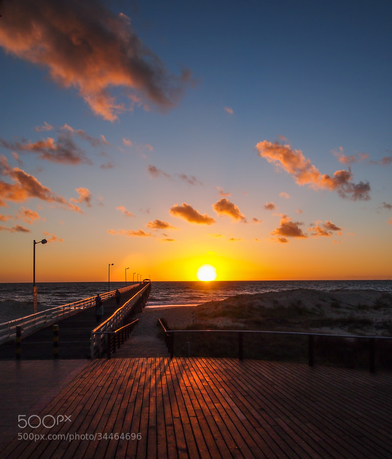 The sunset at Grange Jetty, Adelaide is always something different. My favorite spot to sit back and have a coffee at sunset. This particular day the clouds were sort of floating and dreamy,The look was enhanced by the built in artistic filter of the camHope you like it.