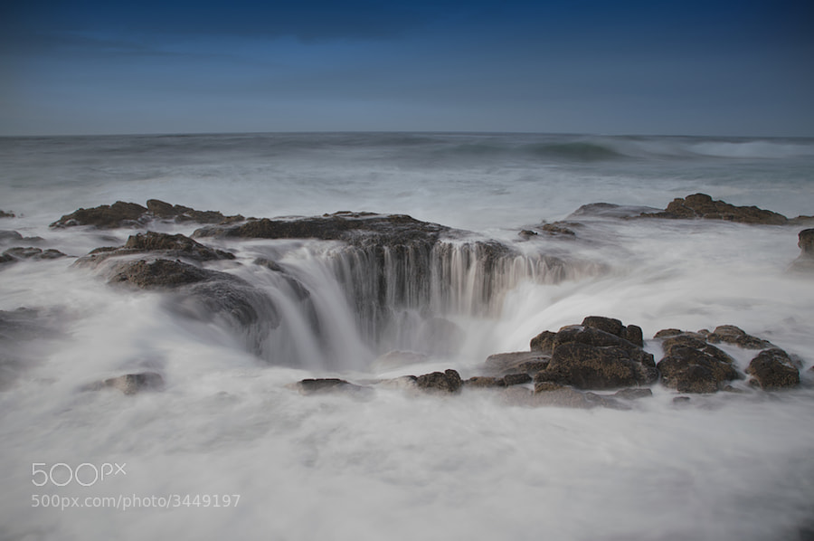 Since I'm in Oregon, I thought I'd give this place a try. I carefully walked up, over all the sharp rocks and tide pools and just at the moment I found the place I wanted to shoot from I got nailed by a big ass wave. Actually, three in succession.  Anyway, here's my first attempt at Thor's Well. I'm sure there'll be more.