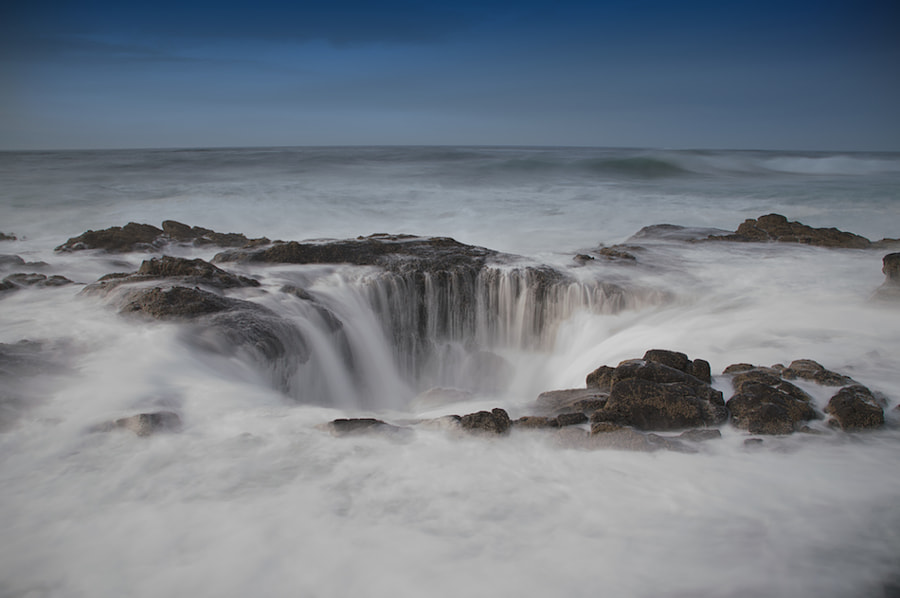 Since I'm in Oregon, I thought I'd give this place a try. I carefully walked up, over all the sharp rocks and tide pools and just at the moment I found the place I wanted to shoot from I got nailed by a big ass wave. Actually, three in succession. 
