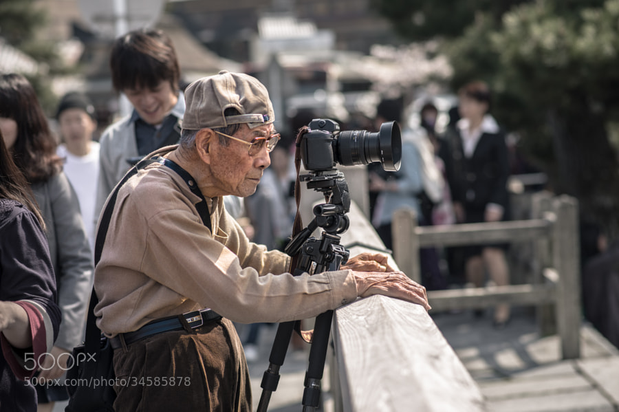 He is nikon photographer. How long have you been doing photography?