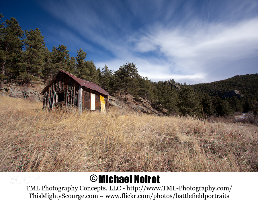 I found this abandoned mountain home near Nederland, Colorado. I like the look of the windswept clouds.  Camera: Canon EOS 5D Mark II Lens: Canon EF 17-40mm f4L USM Zoom: 19mm Shutter: 1/60 second Aperture: f/11 ISO: 200