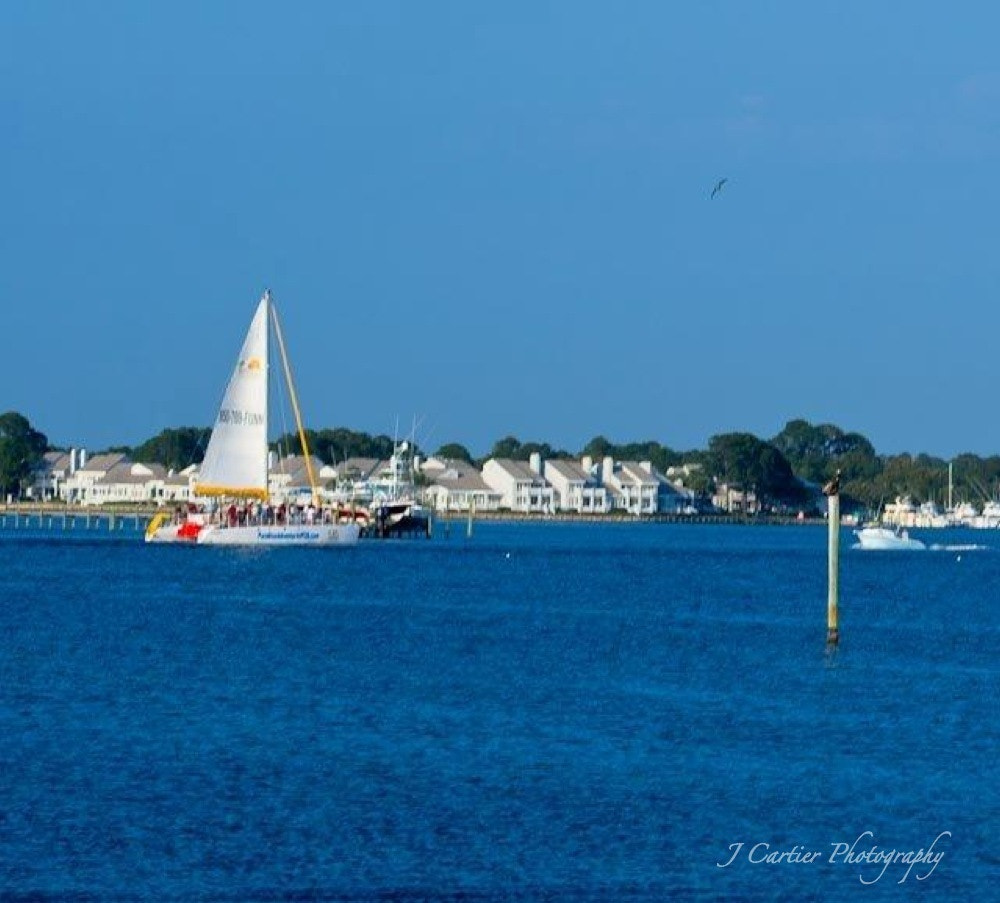 Photograph Catamaran on Grand Lagoon by Jerome Cartier on 500px