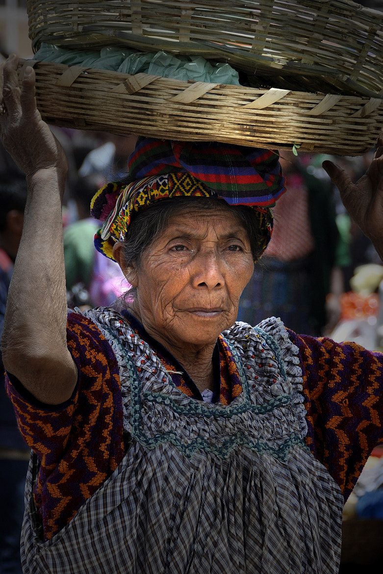 Photograph Lady with Baskets by Tom Bell on 500px
