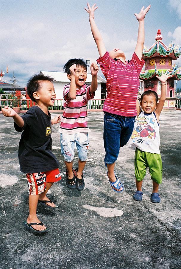 A group of joyful street kids at Hailam Village, Port Klang, Selangor, Malaysia.
