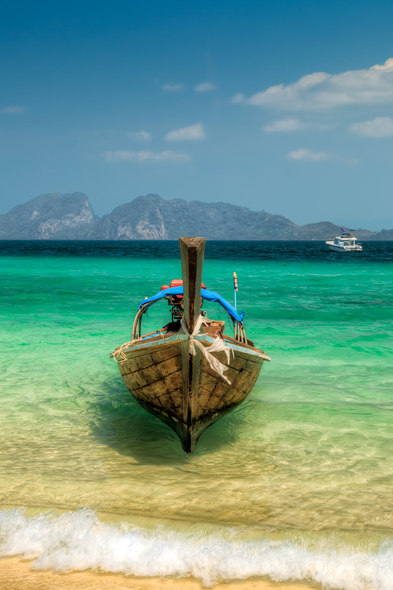 Photograph Moored Longboat by Adrian Evans on 500px