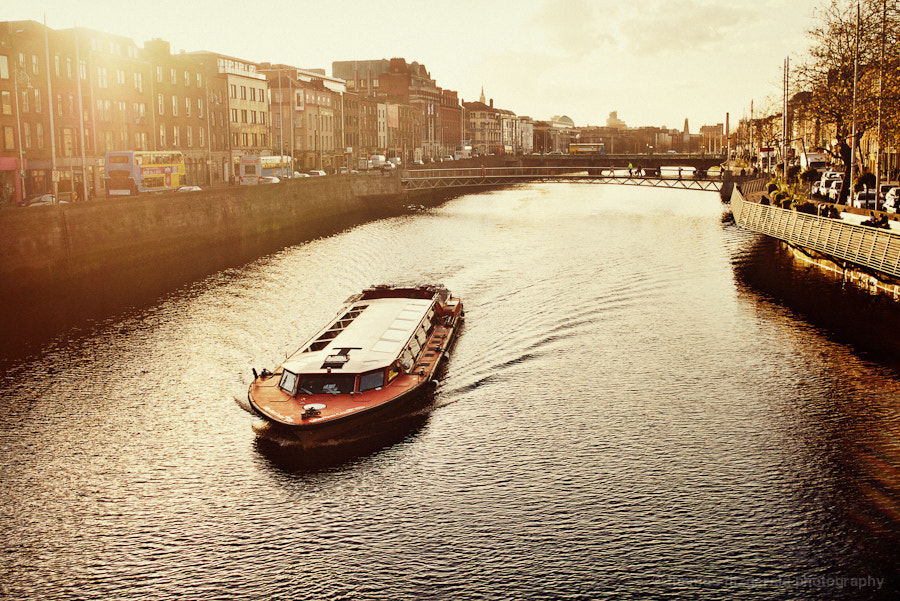 Photograph Tourist boat on the river Liffey by Thomas Fitzgerald on 500px