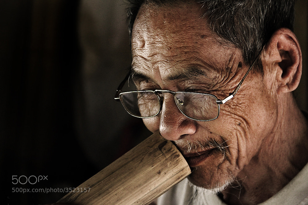 Photograph Old man with tobacco by PITUK JUNTRAPUN on 500px