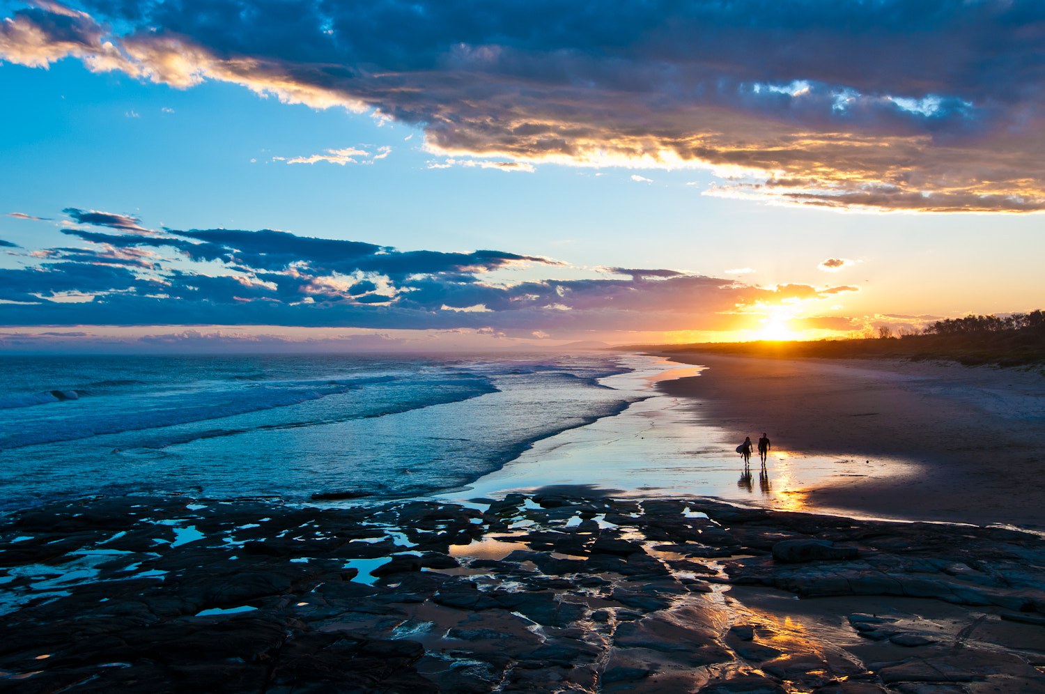 Photograph Sunset Surfers by Kimmo Savolainen on 500px