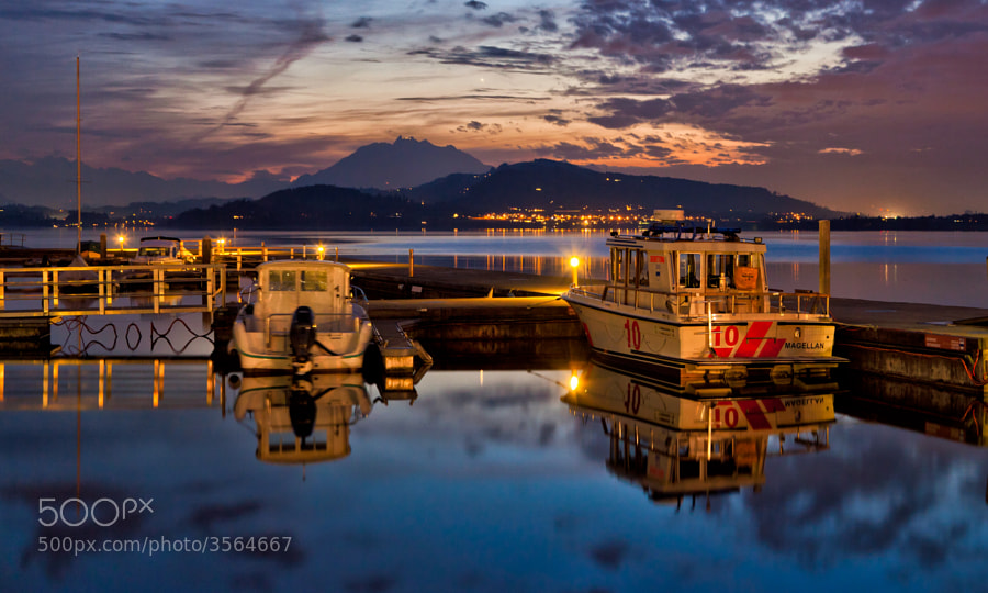 I call that when the brightness of the sky matches the artificial lights, that's the perfect time for shooting urban landscapes without the need for HDR. That was yesterday exactly 1 hour after sunset.  I shot it at the harbor in Zug, Switzerland (where else?) and the mountain in the background is Mount Pilatus.