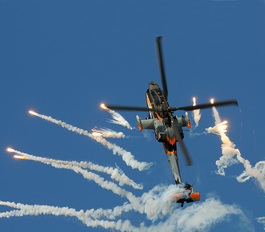 """The Apache Solo Display Team represents the Dutch Air Force at air shows at home and abroad. At home, the Team can be seen performing at the Open Days of the Netherlands Armed Forces.Team Captain Major Roland """"Wally"""" Blankenspoor  and co-pilot Captain Paul 'Wokkel' Webbink fly the Apache combat helicopter. The other members of the crew are two coaches and one technician. The Apache Demo Team is usually employed for recruiting purposes.   Best wishes and have a nice day,  Harry"""
