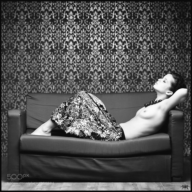 topless photo - nude on the couch by Eugene Putilin