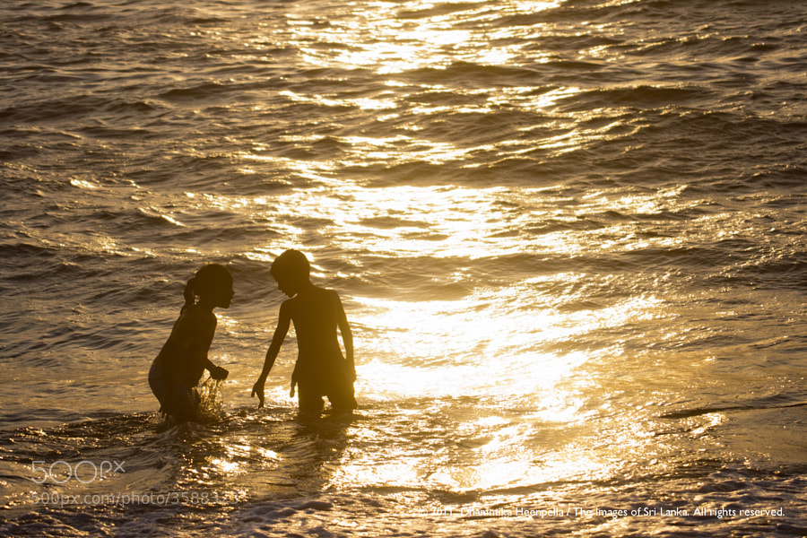 Photograph Two children in the sea by Images of Sri Lanka / Dhammika Heenpella on 500px