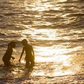 Two children in the sea by Images of Sri Lanka / Dhammika Heenpella (ImagesOfSriLanka)) on 500px.com