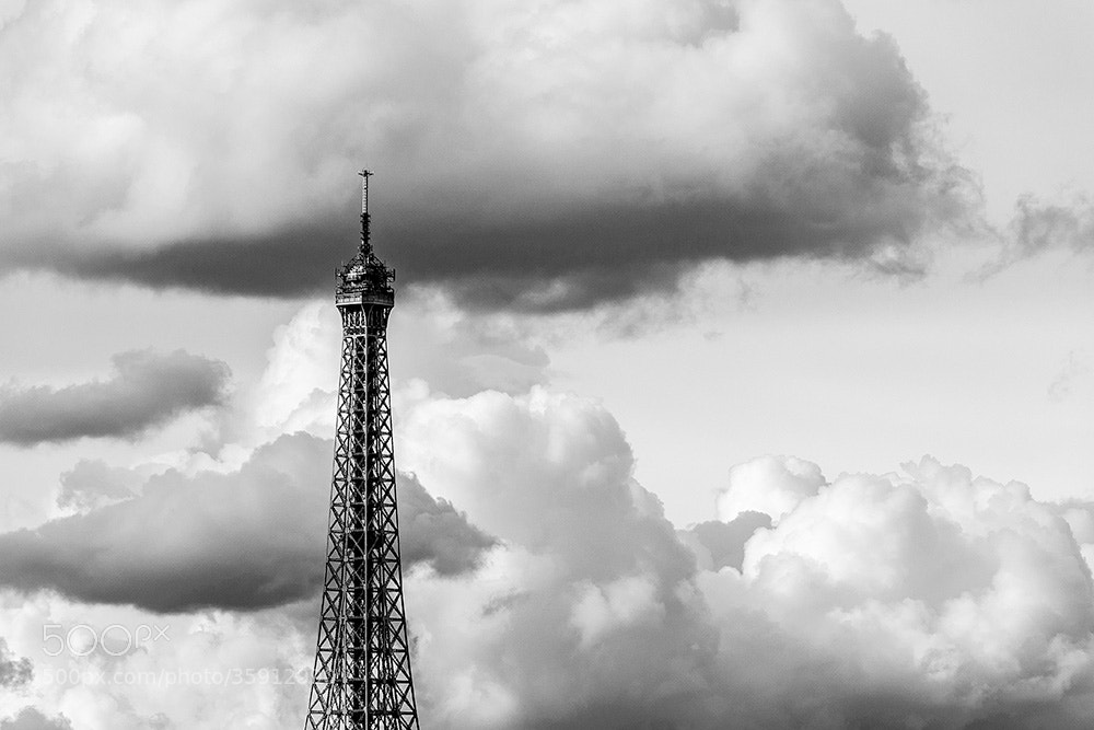 Photograph The Eiffel Tower, head in the clouds by Pierre Nadler on 500px