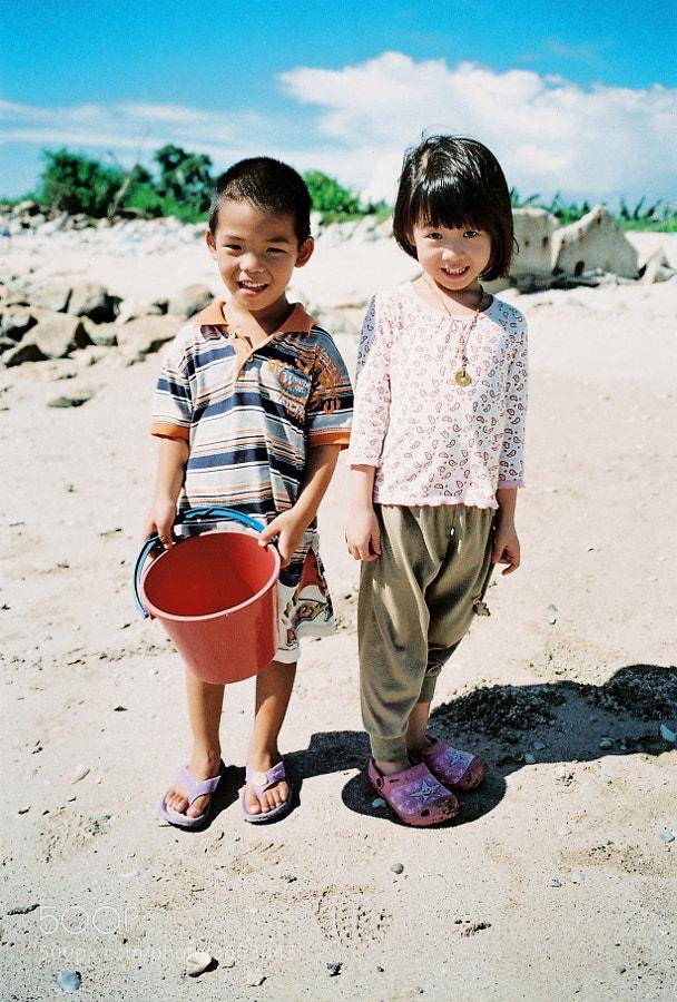 Cute kids at Redang Beach, Sekinchan, Selangor, Malaysia.