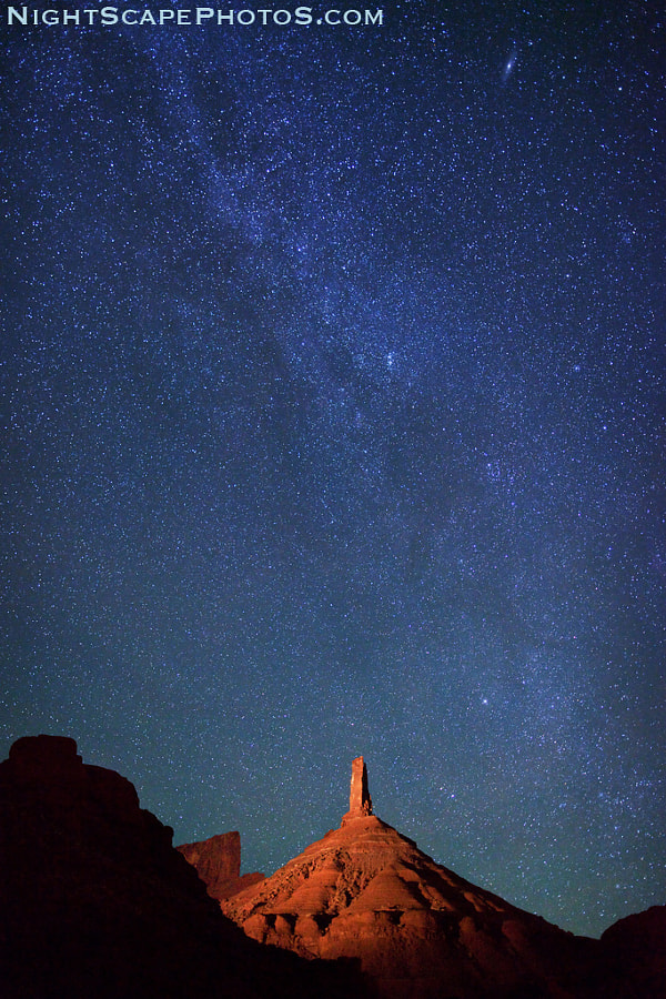 """Starry night sky and the northern tail of the Milky Way over Castle Rock, a sandstone monument in Castle Valley, Utah (about 16 miles northeast of Moab). The top portion of this light-painted monument is called Castleton Tower -- a 400-foot (120 m) sandstone tower standing on a 1,000 foot talus cone, rising a total of 1,400 feet (427 m) above the valley. <a href=""""http://www.flickr.com/photos/ironrodart/6351186051/"""">Here is a 3D map showing how we light paint and photographed this 1,400 foot monument</a>. The 400-foot tower is one the <a href=""""http://www.flickr.com/photos/ironrodart/6351187197/"""">most popular rock climbing sites in North America</a>  Virtually all my NightScapes are ONE exposure (less than 30 seconds), and with very little Photoshop correction. For more how-to and behind the scenes information, visit my <a href=""""http://intothenightphoto.blogspot.com/"""">Into The Night Photography</a> blog. For Milky Way photography workshops, visit my <a href=""""http://intothenightphoto.blogspot.com/2013/11/royce-bairs-2014-photography-workshop.html"""">NightScape Events</a> page. You can <a href=""""http://roycebair.smugmug.com/Personal-Work/Nightscapes/"""">order PRINTS here</a>."""