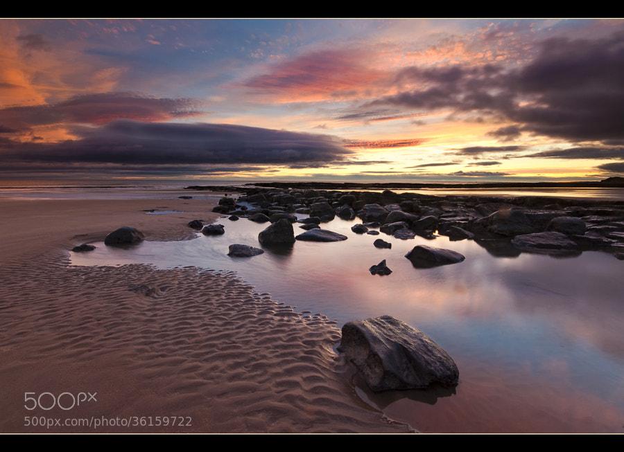 Sunrise at Cocklawburn beach on the Northumberland coast.
