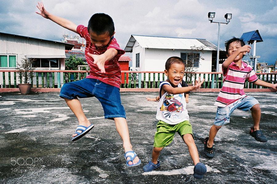 Playful kids at Hailam Village, Port Klang, Selangor, Malaysia.