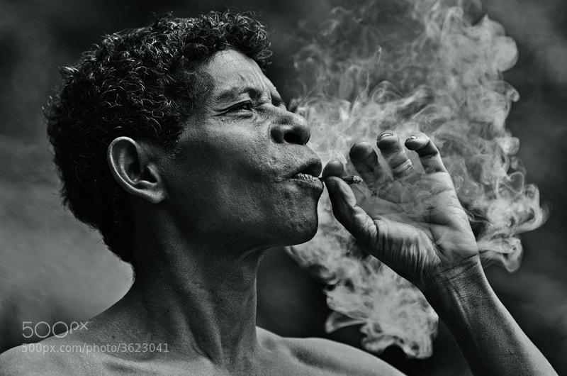an Orang Asli man in Royal Belum Rain Forest