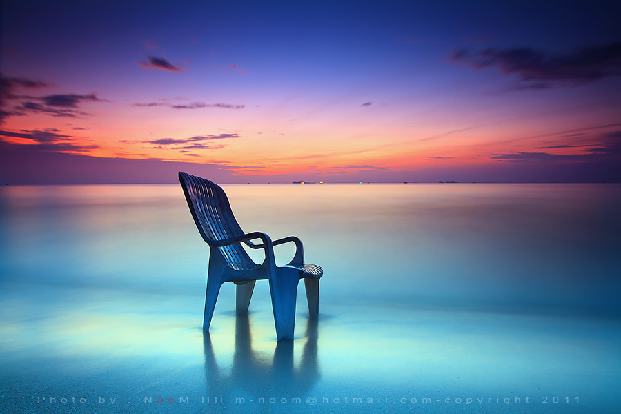 Photograph Lonely chair on the beach by noom  HH on 500px