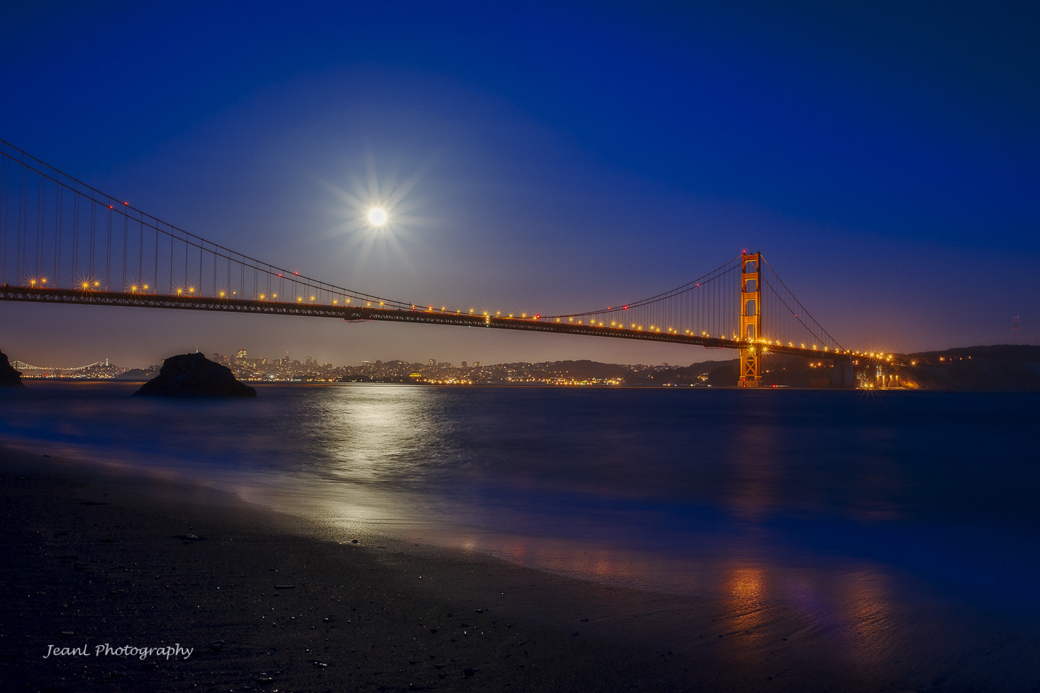 Photograph The Full Moon over Golden Gate Bridge by Jean Li on 500px