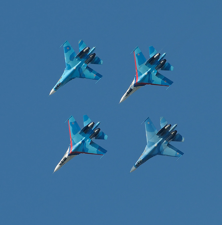 """""""Falcons of Russia"""" is an aviation group of aerobatics of Military and air forces of Russia. It is created in 2006 on the basis of the Lipetsk aviacenter for the purpose of demonstration of fighting opportunities of military planes let out in Russia.Pilots of group carry out single and group movements on fighters of the fourth generation Su-27 Flanker.  Shot taken at MAKS in Moscow - Zhukovsky, Ramenskoye.  Best wishes and have a nice day,  Harry"""