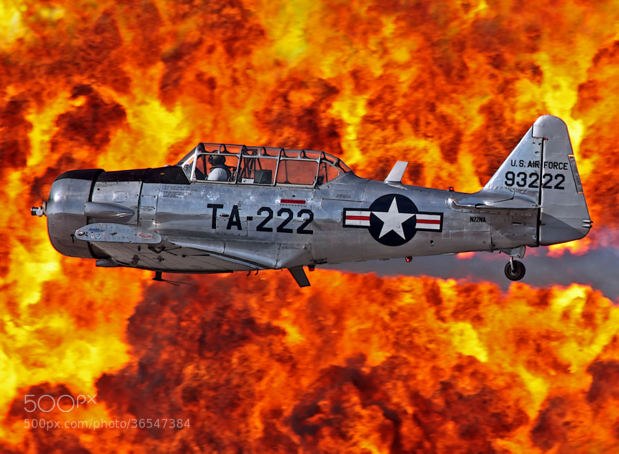 Air Show performer Bill Leff flying his T-6 Texan and photographed a moment before being passed by the Shockley Shockwave Jet Truck at the 2010 NAS Pensacola Air Show.