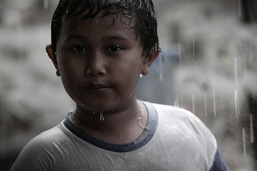 Photograph playing in rain by Arief  Wibisono on 500px