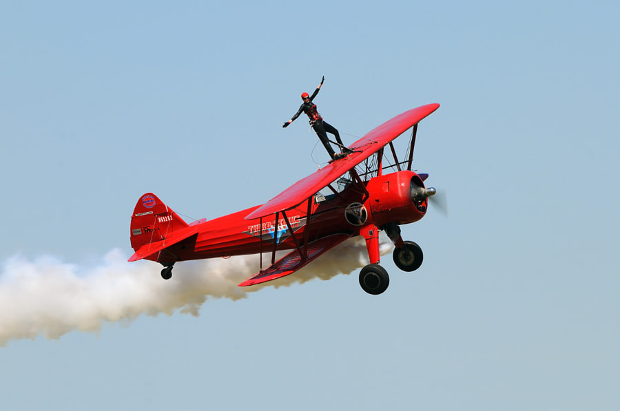 Carol Pilon from Masham, Quebec, Canada, on top of a Boeing Stearman of Third Strike Wing walking, during an Aviation event in New Orleans, Louisiana.  Carol is the first and only Canadian wing walker.  Best wishes and have a nice day,  Harry