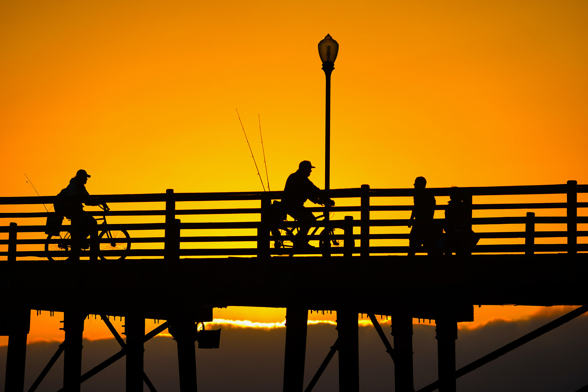 Photograph Fishermen on Bikes at Sunset on the Oceanside Pier - June 4, 2013 by Rich Cruse on 500px