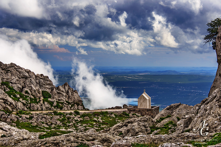View from the Velebit mountain towards Karin sea, Ravni Kotari (Flat Counties) and Adriatic sea and islands, as clouds rise in the western flow