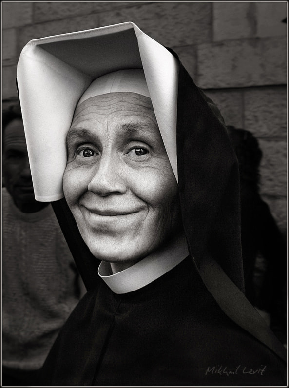 Photograph Portrait of nun by Mikhail Levit on 500px