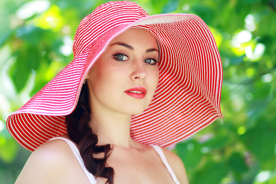 woman in bright summer hat by Olena Zaskochenko on 500px.com