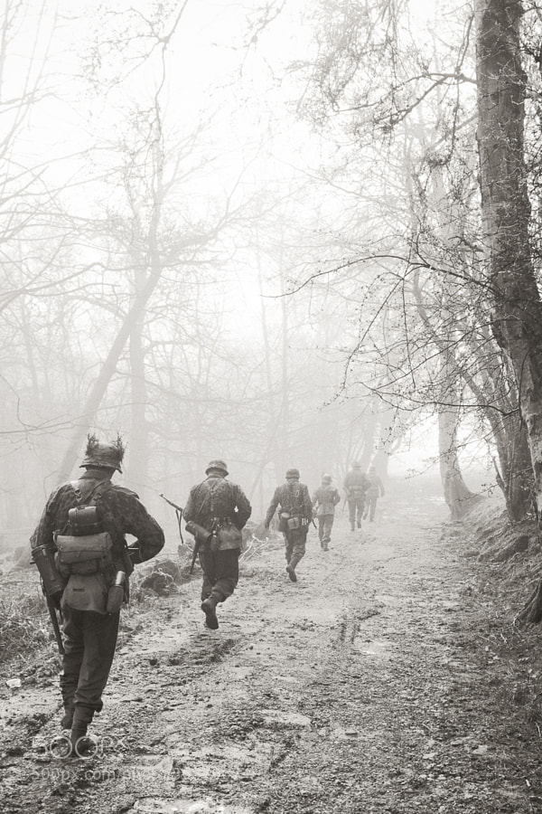 German grenadiers march through the eery early morning mists whilst on Patrol.