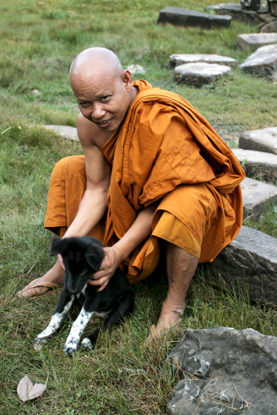 Photograph Buddhist Monk and his Dog at Bayon by John Lander on 500px