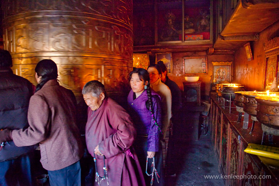 Photograph Pilgrims and Prayer Wheel by Ken Lee on 500px