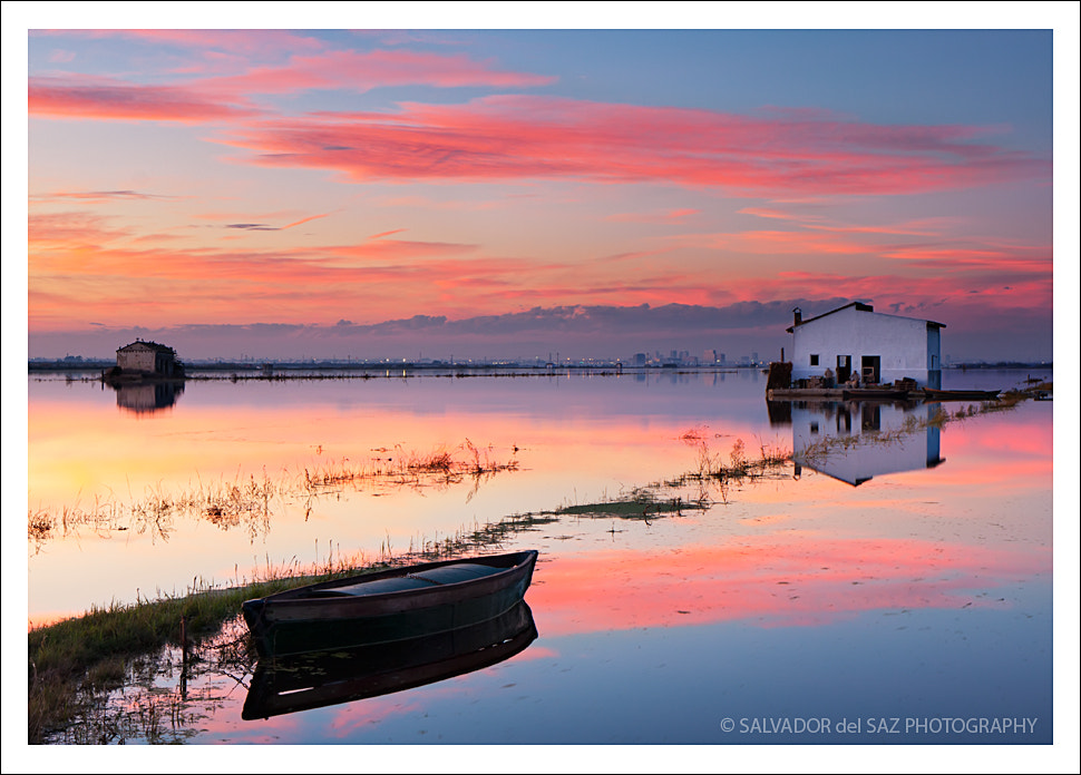 Photograph Flooding the rice fields (the lonely boat and the house) by Salvador del Saz on 500px