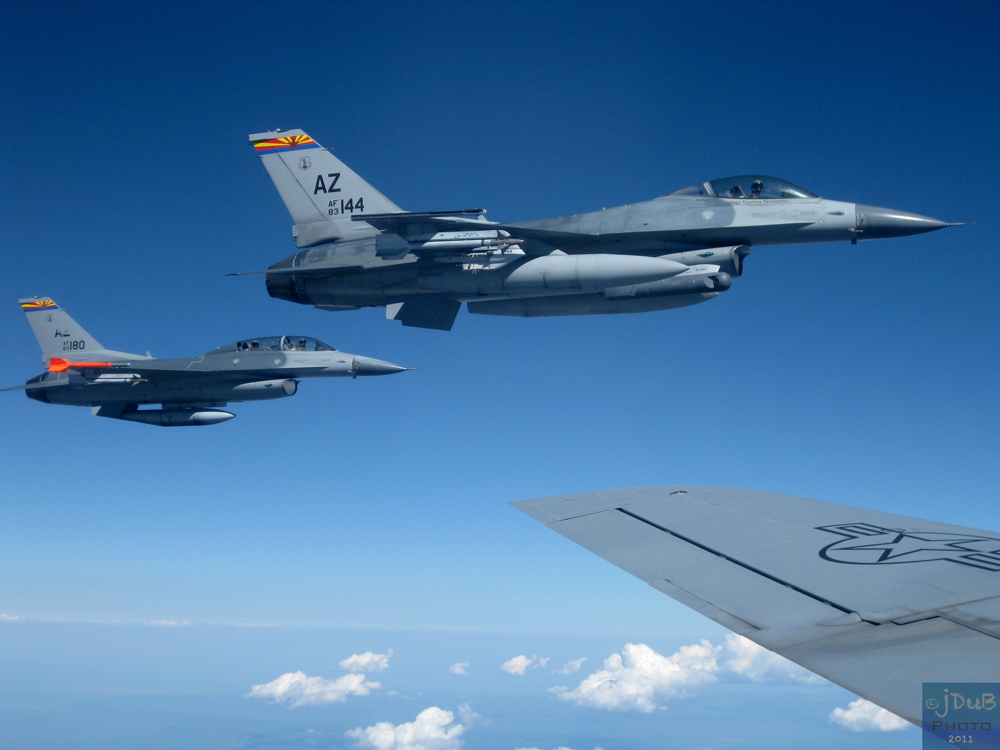 Photograph F-16s Flying next to a KC-135 by Johnny Smith on 500px