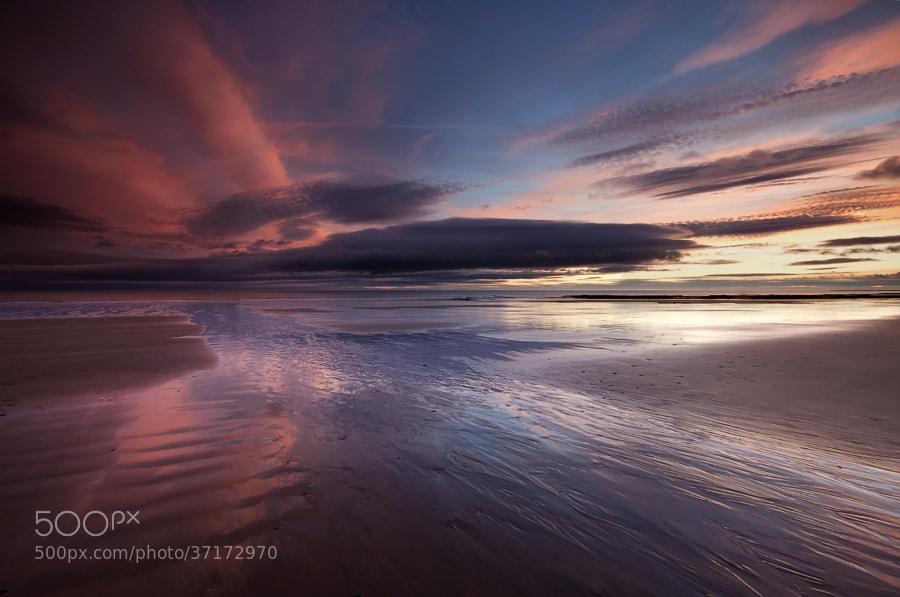 Sunrise on Cocklawburn beach in Northumberland.
