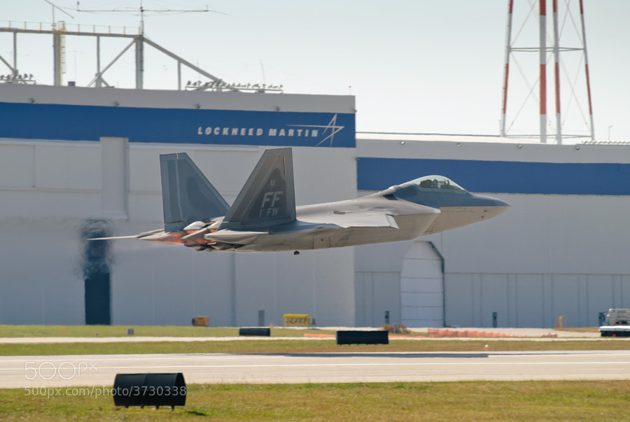 An F-22A Raptor takes off in front the the Marietta, Georgia factory where it was made.
