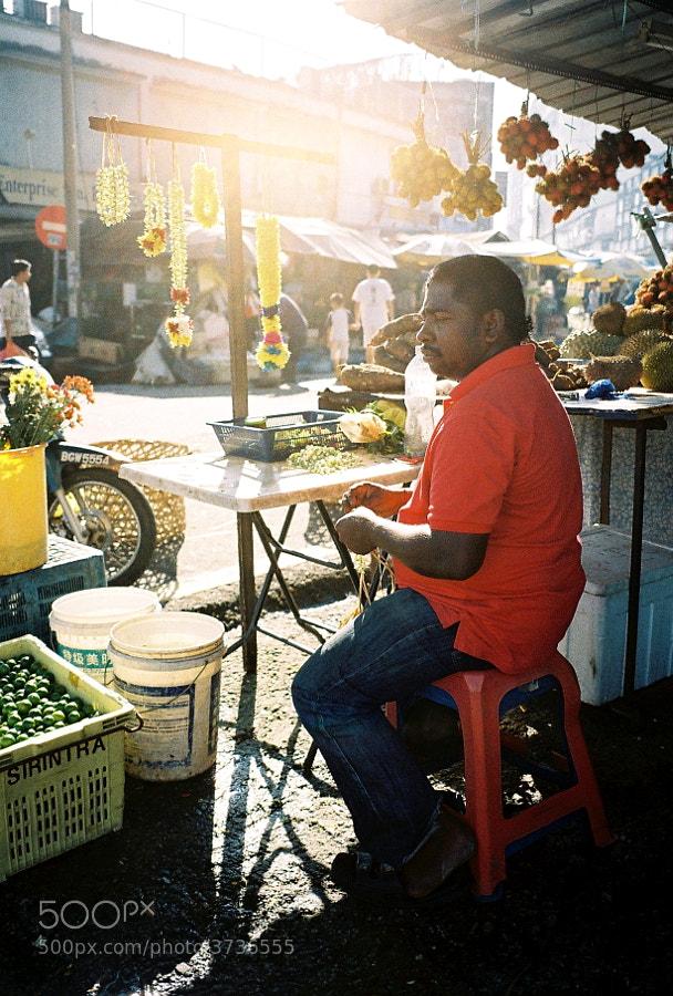 Garland flower seller at morning market in Pudu, Kuala Lumpur, Malaysia.