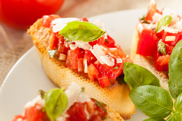 Photograph Homemade Tomato and Basil Bruschetta by Brent Hofacker on 500px