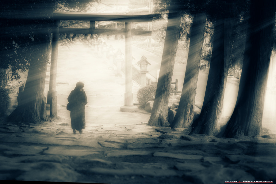 Old lady and the shrine by Adam Lewis on 500px.com